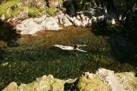 Naked Woman Swimming in River